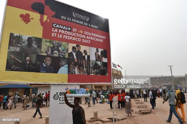 People arrive to attend the opening ceremony of the 25th edition of the Panafrican Film and Television Festival of Ouagadougou on February 25 2017 in...