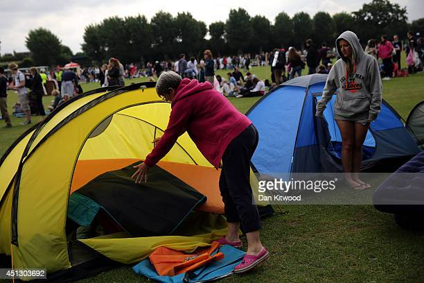 People arrive to camp in the queue for entrance to the 'All England Lawn Tennis and Croquet Club' ahead of the start of day five of the Wimbledon...