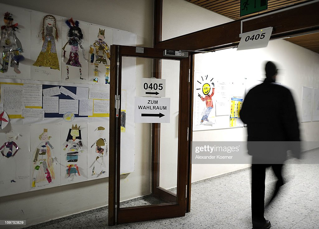 People arrive to cast their ballots at a polling station as the Lower Saxony eletions get underway on January 20, 2013 in Hanover, Germany. The elections are being seen by many as a strong indicator for the general elections scheduled for later this year.