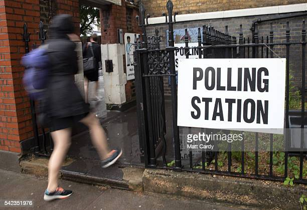 People arrive to cast their vote at a polling station at Pakeman Primary School in Islington on June 23 2016 in London England The United Kingdom has...
