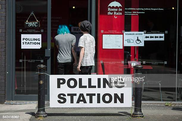 People arrive to cast their vote in the European Union referendum at the Anthony Burgess Foundation polling station in Manchester UK on Thursday June...