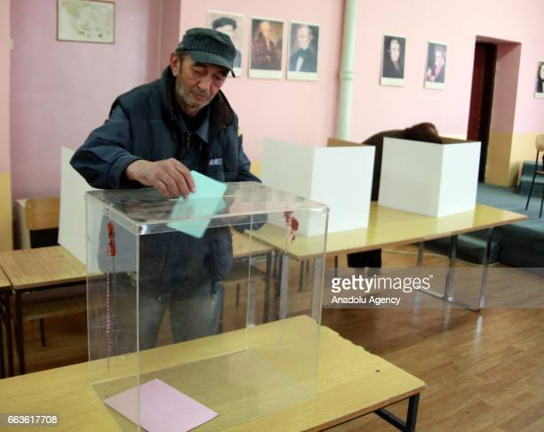 People arrive to cast their votes at a polling station during the Presidential elections in Belgrade Serbia on April 02 2017
