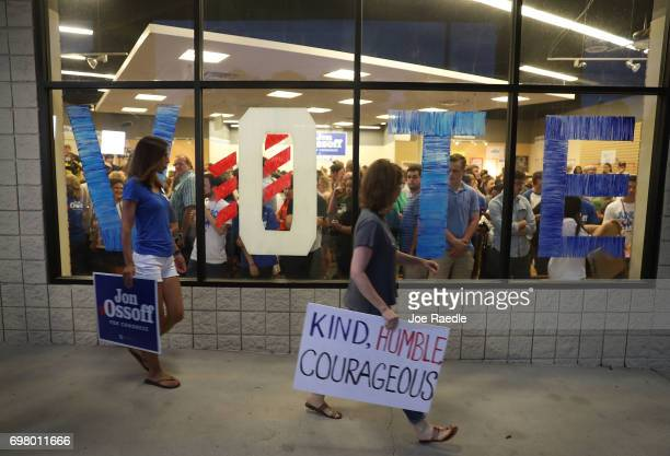 People arrive to hear Democratic candidate Jon Ossoff speaks during a rally to thank volunteers and supporters on the last night before election day...