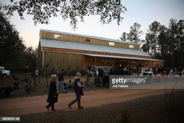 People arrive to hear Republican Senatorial candidate Roy Moore speak during a campaign event at Jordan's Activity Barn on December 11 2017 in...
