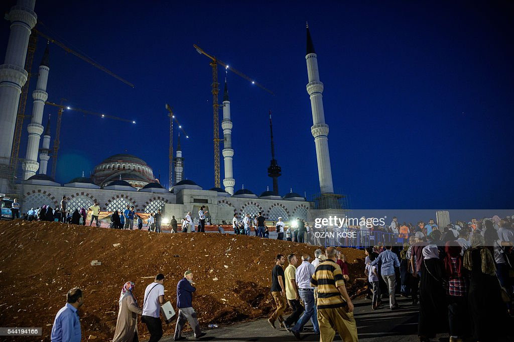 People arrive to pray at the new Camlica mosque in Istanbul on July 1, 2016. Istanbul's towering Camlica mosque received its first worshippers, as Turkey unveils the latest grand project emblematic of President Recep Tayyip Erdogan's big ambitions. Erdogan personally supervised the controversial construction of Turkey's biggest mosque -- designed to accommodate up to 60,000 worshippers and visible to all from its perch on a hill on Istanbul's Asian side. / AFP / OZAN