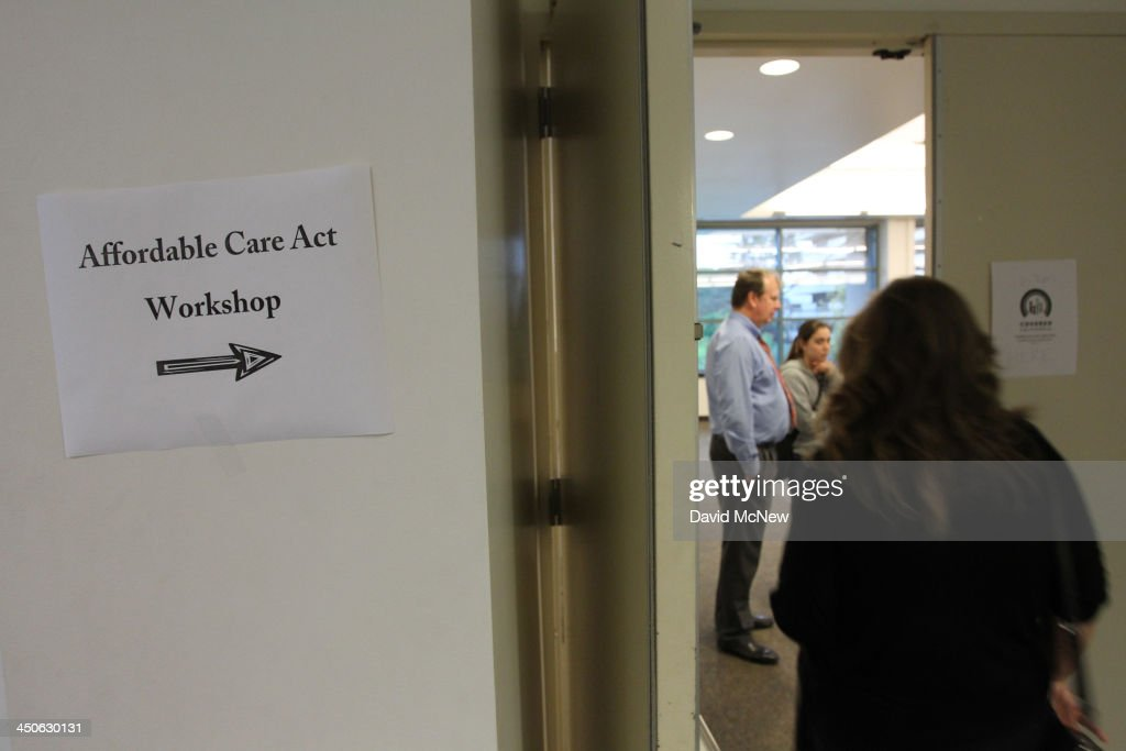 People arrive to the free Affordable Care Act Enrollment Fair at Pasadena City College on November 19 2013 in Pasadena California The event sponsored...