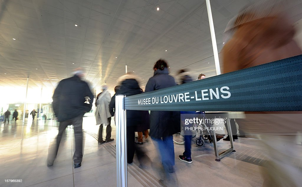 People arrive to visit the Louvre-Lens museum on December 8, 2012 in Lens, northern France. The Louvre museum opened a new satellite branch among the slag heaps of a former mining town on Dcember 4, 2012 in a bid to bring high culture and visitors to one of France's poorest areas. AFP PHOTO PHILIPPE HUGUEN