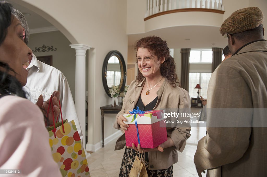 People arriving at house with presents for a party : Stock Photo