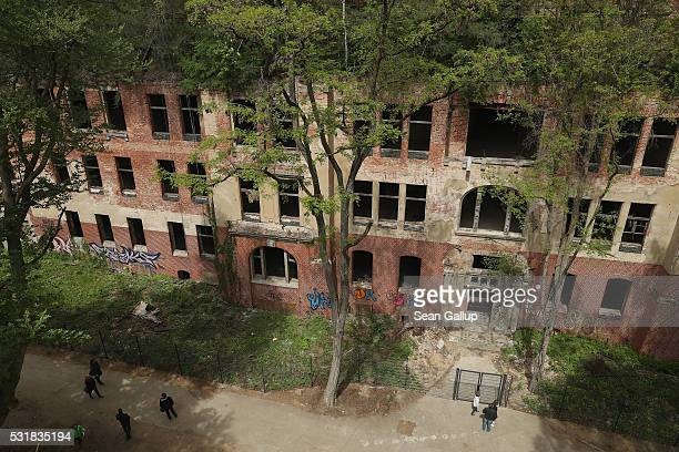 People as seen from the 'Baum und Zeit' elevated platform walk along the ruins of the Beelitzer Heilstaetten sanatorium on May 16 2016 in Beelitz...