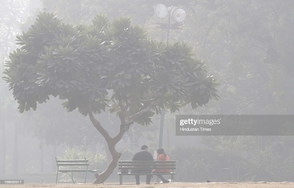 People at a Lodi garden during foggy and cold morning on January 6, 2013 in New Delhi, India. Setting a new low for temperature this winter, mercury in the national capital on Sunday fell to 1.9 degrees Celsius - five notches below average. This is the lowest recorded in Delhi in five years.