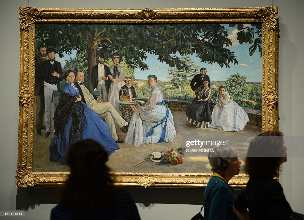 People at a media preview look at 'Family Reunion, 1867' (R) by Jean-Ferderic Bazille in the exhibition 'Impressionism, Fashion, and Modernity' February 19, 2013 at The Metropolitan Museum of Art in New York. The look at the role of fashion in the works of the Impressionists and their contemporaries shows 80 major paintings with period costumes, accessories, fashion plates, photographs, and popular prints. AFP PHOTO/Stan HONDA