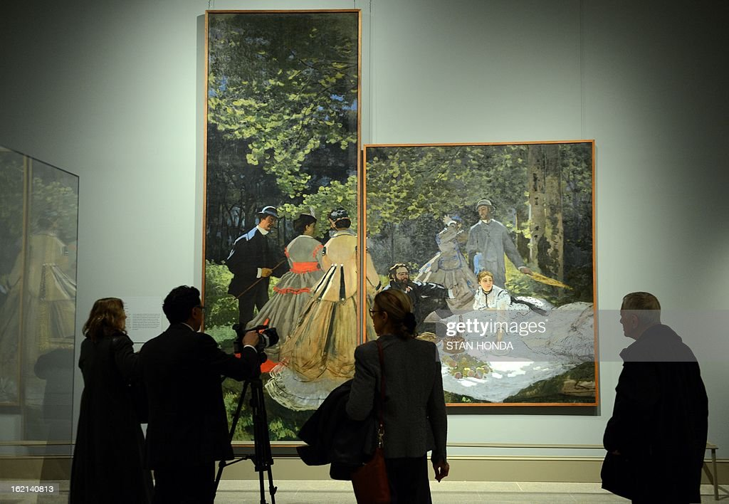 People at a media preview look at 'Luncheon on the Grass, 1865-66' (L, large panel) and 'Luncheon on the Grass, 1865-66' (R) by Claude Monet in the exhibition 'Impressionism, Fashion, and Modernity' February 19, 2013 at The Metropolitan Museum of Art in New York. The look at the role of fashion in the works of the Impressionists and their contemporaries shows 80 major paintings with period costumes, accessories, fashion plates, photographs, and popular prints. AFP PHOTO/Stan HONDA
