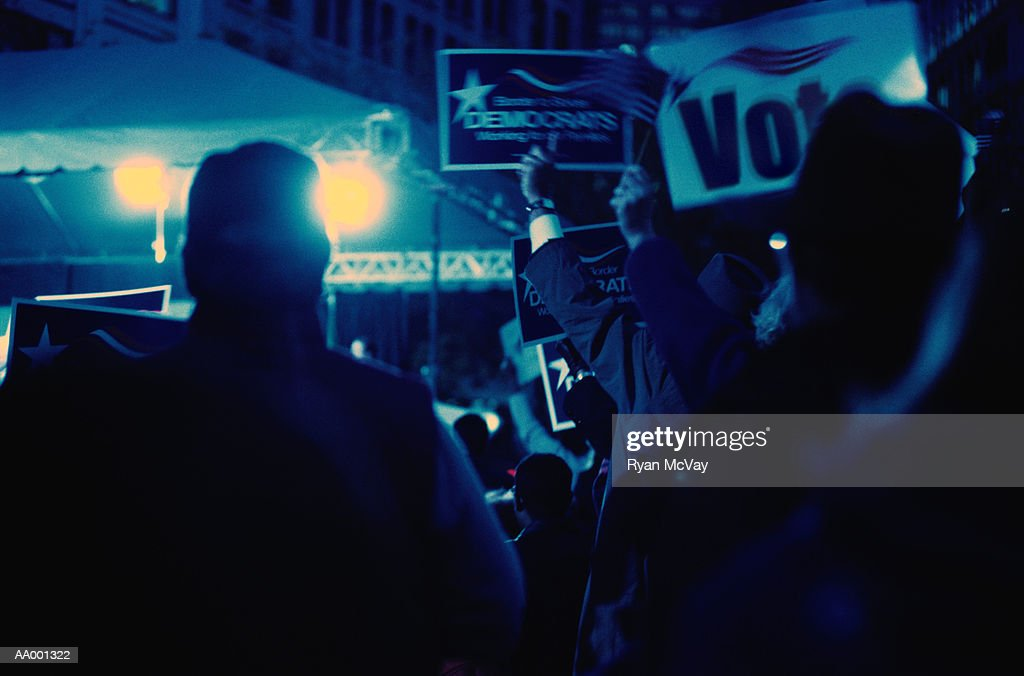 People at a Nightime Political Rally : Stock Photo