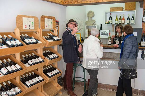 People at a winery tasting wines in the village of ChateauneufduPape which is in the Vaucluse department ProvenceAlpesC��te d'Azur region in...