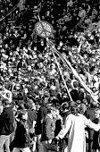 People at an early antiVietnam War gathering at Kezar Stadium San Francisco California late 1960s