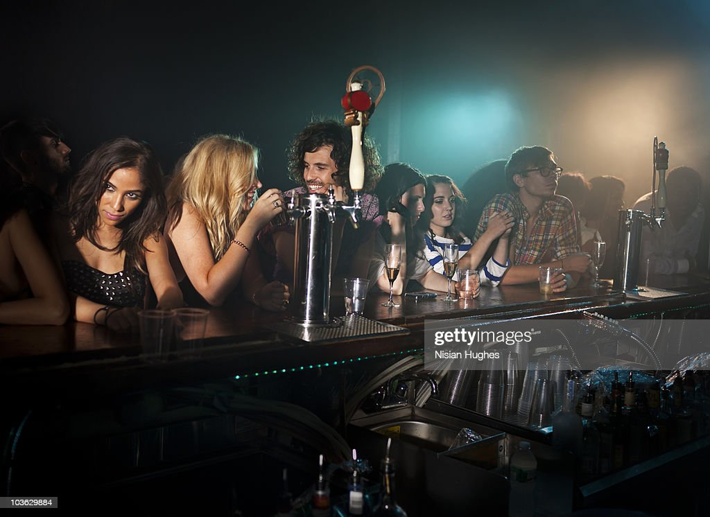 people at bar in nightclub