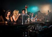 people at bar in nightclub