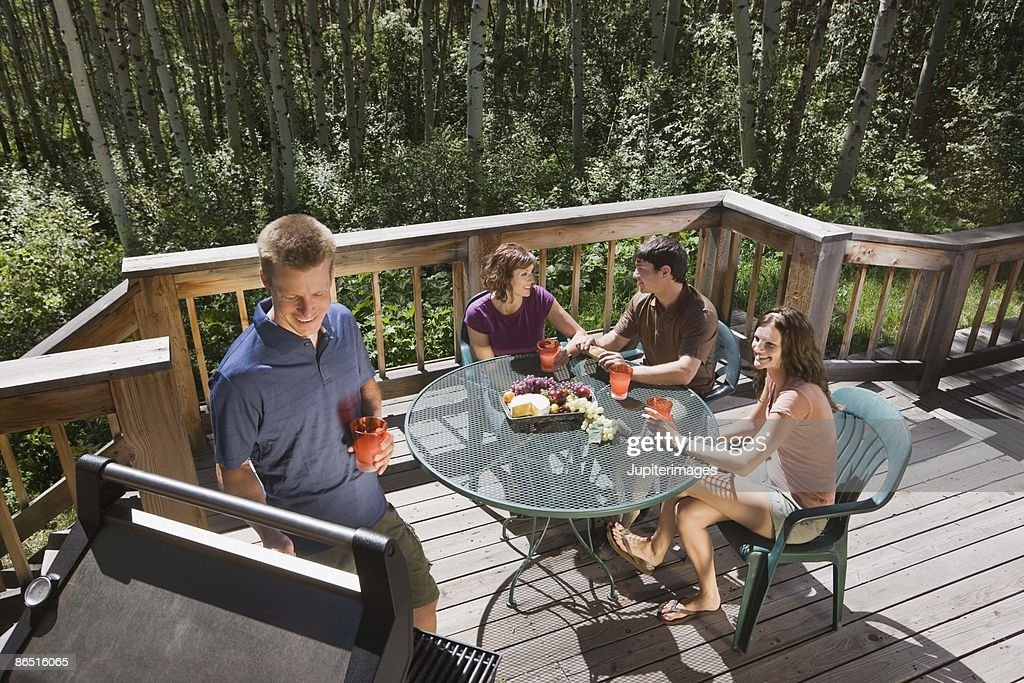 People At Barbecue On Patio Deck : Stock Photo