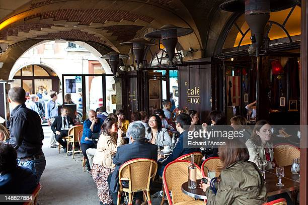 People at Cafe Hugo at Place des Vosges in Marais.