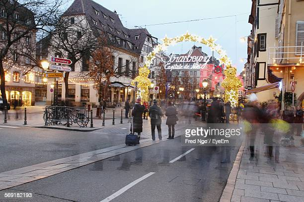 People At Decorated City Street For Christmas