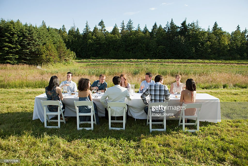 People at dinner party on a farm : Stock Photo