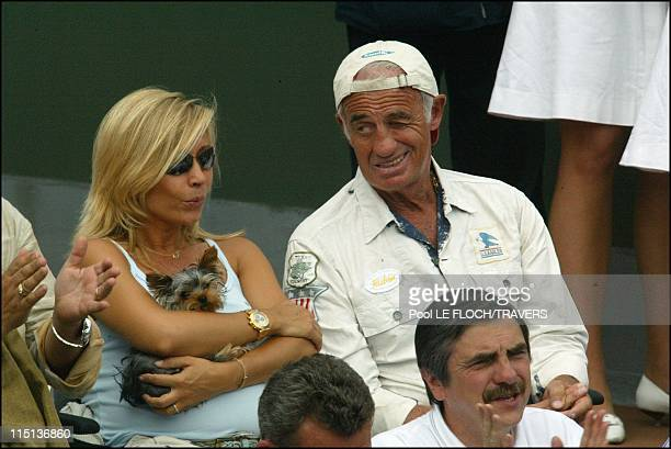 People at French tennis open at Roland Garros in Paris France on June 05 2003 Jean Paul Belmondo and his wife Natty