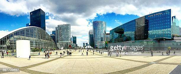People At La Defense Against Sky