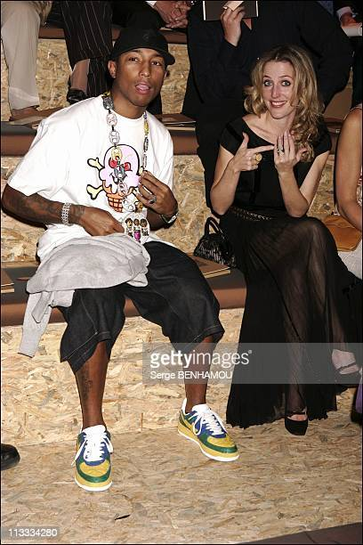 People At Louis Vuitton Ready To Wear SpringSummer 2006 Fashion Show On October 9Th 2005 In Paris France Here Pharell Williams And Gillian Anderson