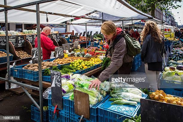 People at market stall at Albert Cuypmarkt