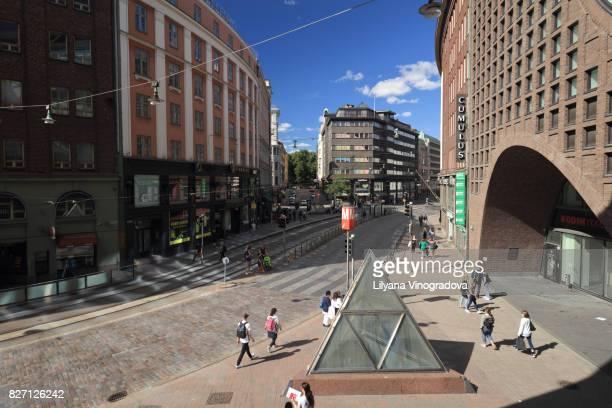 People at metro station 'University of Helsinki' in Helsinki, Finland