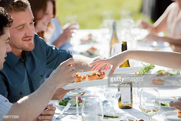 People at outdoor dinner party