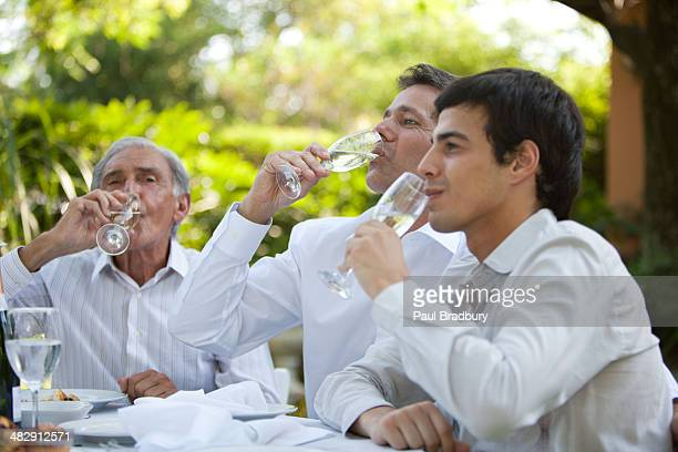People at party table with drinking white wine