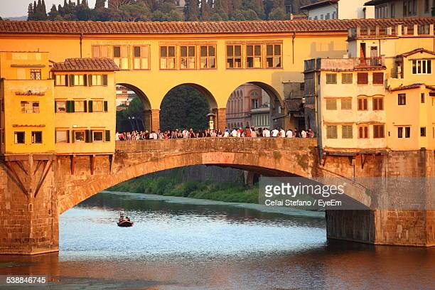 People At Ponte Vecchio Over River