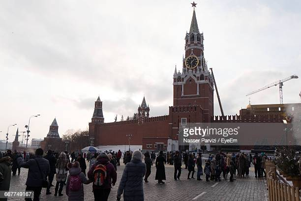 People At Red Square By Spasskaya Tower Against Sky