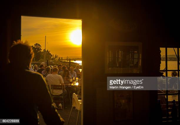 People At Restaurant During Sunset