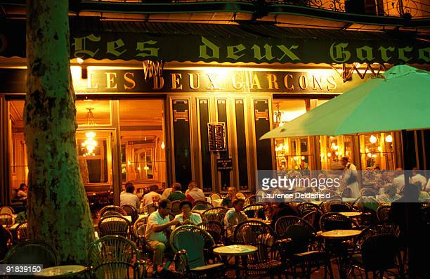 People at sidewalk cafe at night, Mirabeau, France