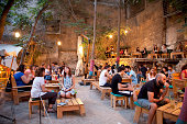 People at Six Dogs a trendy outdoor bar in the Monastiraki area six dogs is a day night cultural entertainment center at the heart of Athens which...