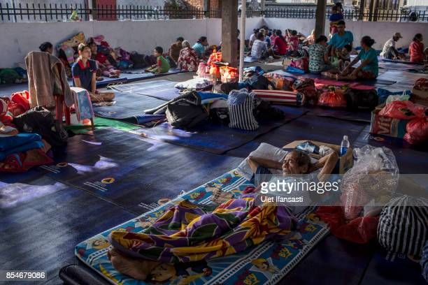 KARANGASEM BALI INDONESIA SEPTEMBER 27 People at temporary shelter after being evacuated from their village at Manggis village on September 27 2017...