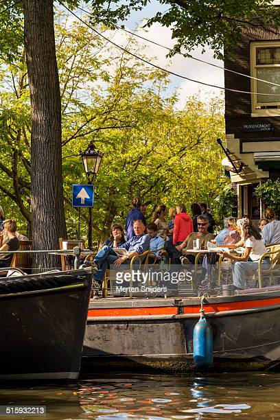 People at terrace along Prinsengracht canal