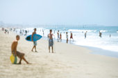 people at the beach in the summer, defocused