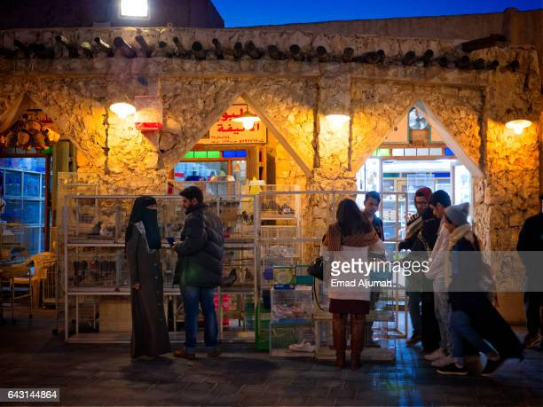 People at the birds market in Souq Waqif, Doha, Qatar - February 3, 2017