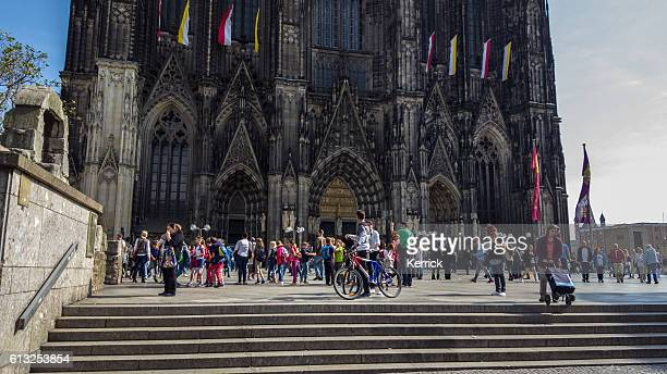 people at the bottom of the Cologne Cathedral Germany