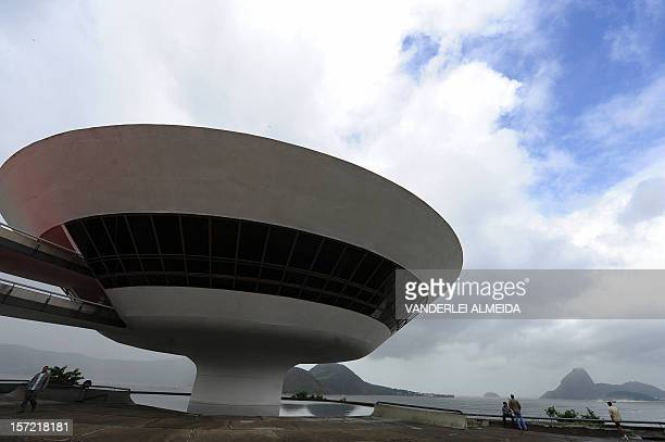 People at the Contemporary Art Museum designed by Brazilian architect Oscar Niemeyer in Niteroi a city 25 km from Rio de Janiero just across...
