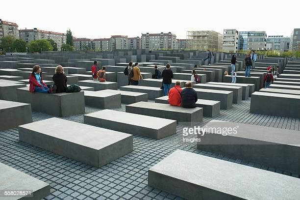 People At The Memorial To The Murdered Jews Of Europe Berlin Germany
