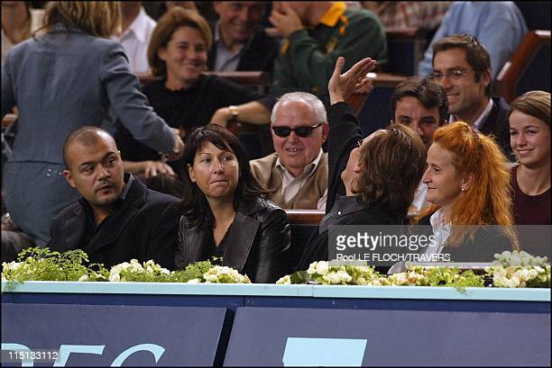 People at the Paribas tennis master men final in Paris France on November 03 2002 Evelyne Thomas and friend Gilbert Montagne and wife