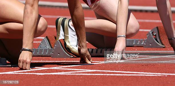 People at the starting line on a race track
