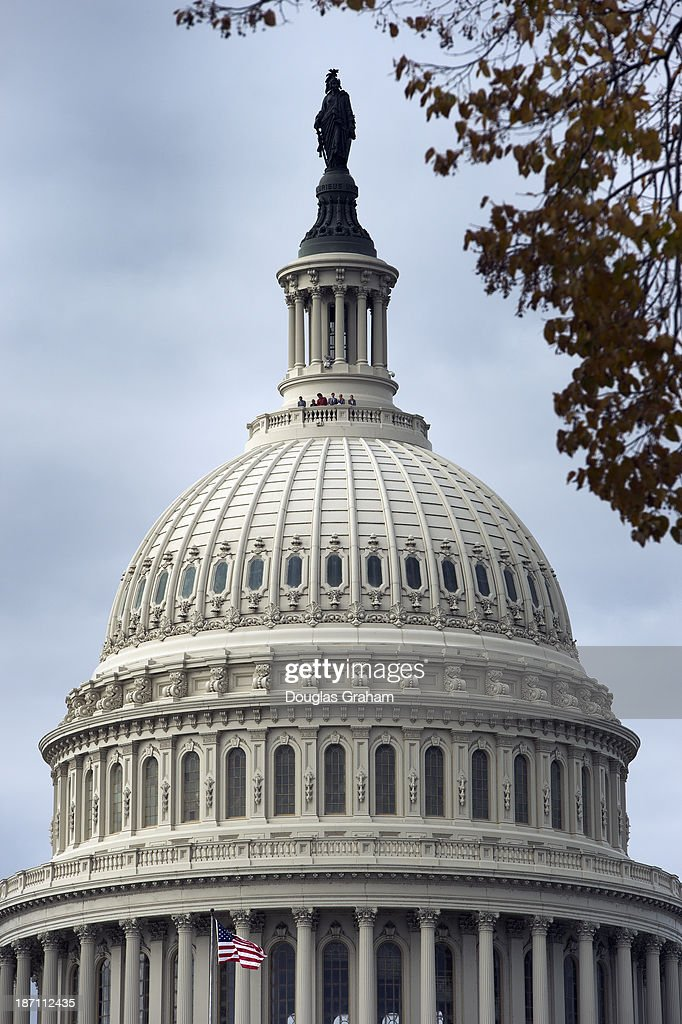 People at the top of the U.S. Capitol Dome look out over the East Front Plaza on Wednesday November 6, 2013.