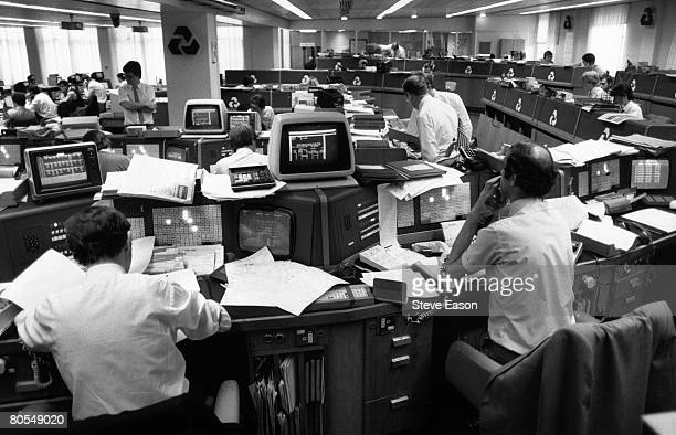 People at work on computers in an office at a National Westminster bank circa 1990