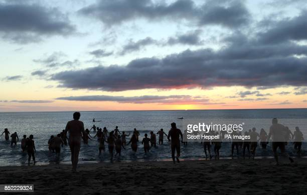 People attempt to set a new world record for the biggest ever skinny dip at Druridge Bay in Northumberland