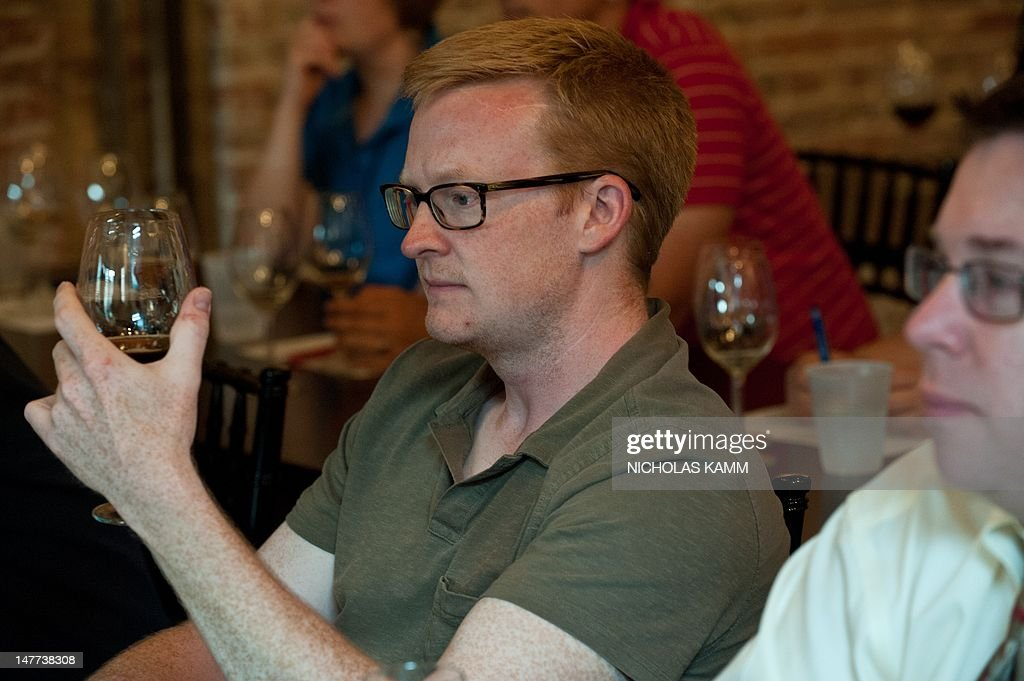 People attend a beer history event at Living Social in Washington on June 26, 2012. Online coupons are last year's news.That is the view from number two US online deals firm Living Social, which is battling sector leader Groupon by offering what excutives call 'unique' or original experiences that are not simply linked to discounts. AFP PHOTO/Nicholas KAMM